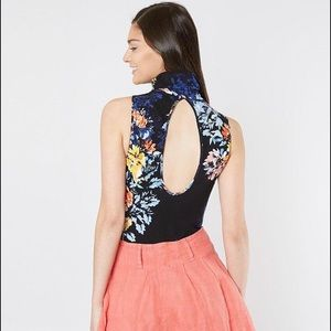 NWT. Free people pick floral body suit .